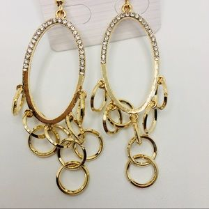 EARRINGS CRYSTAL OVAL WITH GOLDEN CIRCLES.